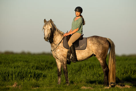 Gabi Neurohr with Shagya Arabian mare Mayana on trail ride